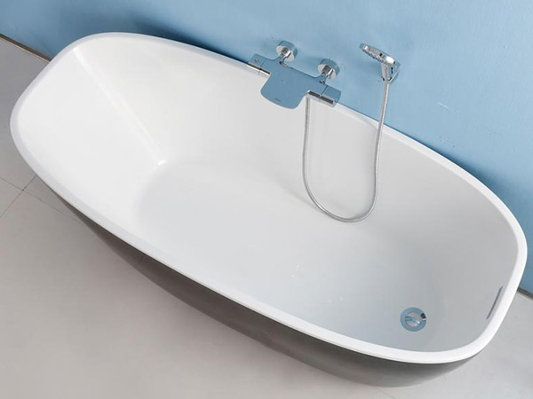 Deep freestanding bath from top view with wall hung faucet