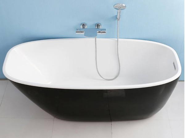 Black deep freestanding bath with wall hung faucet