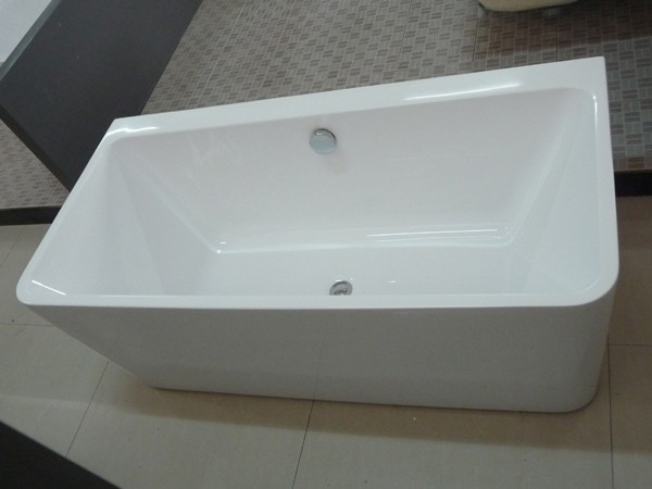Small freestanding soaking tub displays in the showroom
