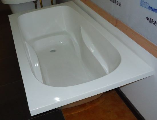 Rectangular undermount soft tub in showroom