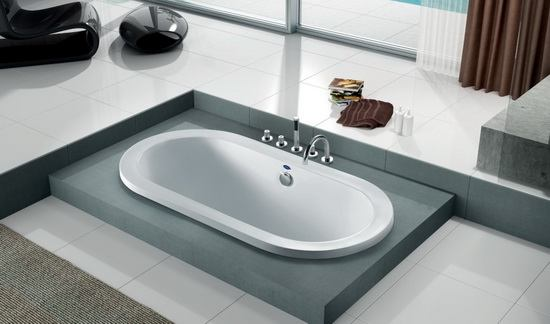Oval drop in soft tub in bathroom